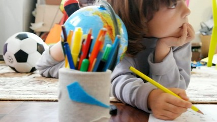 Children draw in home