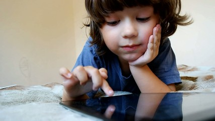 boy use tablet pc indoors