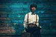 Leinwandbild Motiv Smoking vintage african american senior jazz musician with trump