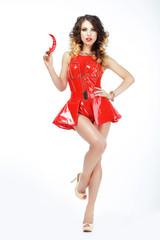 Playful Woman in Red Latex Dress with Hot Chili Pepper