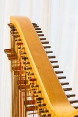 Celtic harp close-up string adjustment
