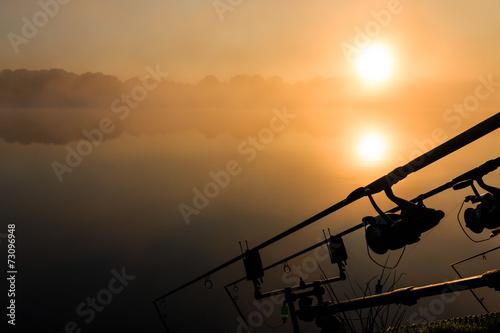 Papiers peints Lac / Etang Carp fishing rods misty lake France
