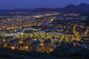 Aerial night cityscape of Brasov city