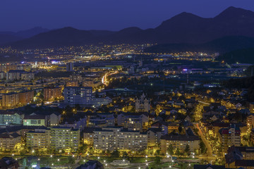 Aerial night cityscape of Brasov city, Romania