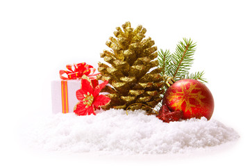 Fir cones and red christmas ball isolated on white.
