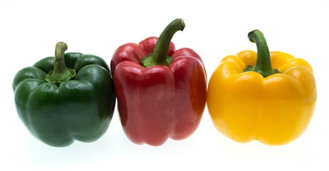 Three sweet peppers in red, yellow and green color