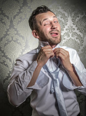 Funny businessman get dressed necktie or cravat.