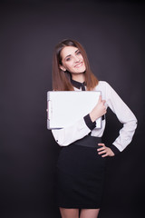 smiling business woman holding blank clipboard