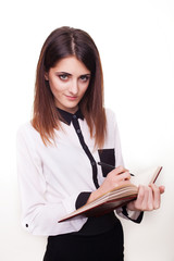 Attractive young woman taking notes in order not to forget somet