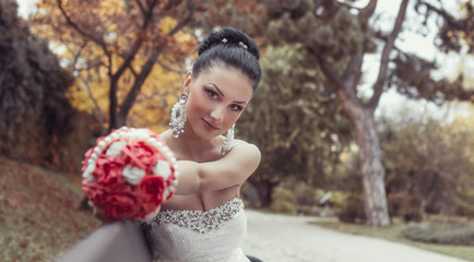 Portrait of a beautiful bride holding bouquet