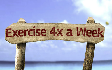 Exercise 4x a Week sign with a beach on background