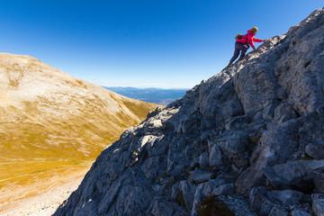 Woman climbong mountain slope