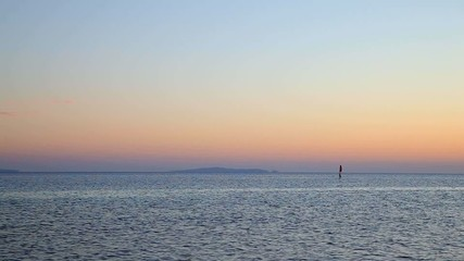 expanse of the sea and the island on the horizon