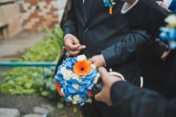 Bunch of flowers in hands 1283.
