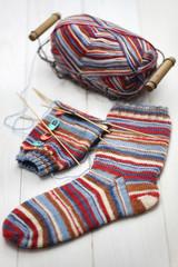 knitting winter warm socks, yarn ball and knitting needles