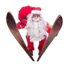 Santa Claus jumps on skis