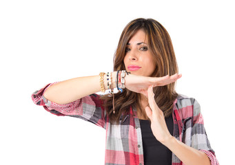 Girl making time out gesture over white background