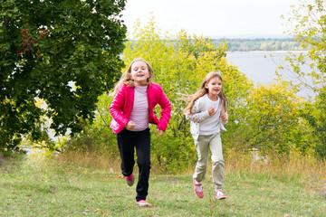 Cute two running girls