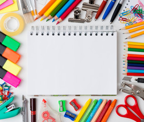 Blank notebook with colourful crayons