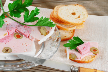 Duck pate with olives. French cuisine.
