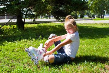 Cute girl put on roller skates