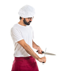 chef sharpening a knife