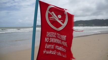 no swimming, red warning flag, hand camera