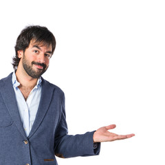 Handsome man having doubts over isolated white background