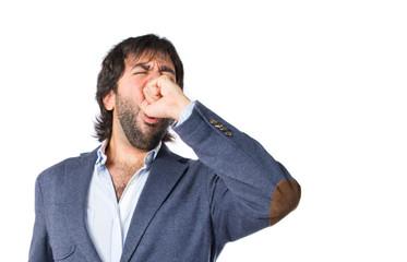 Man yawning over isolated white background