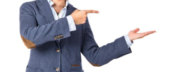Businessman holding something over white background