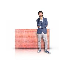 Businessman thinking with rectangular placard