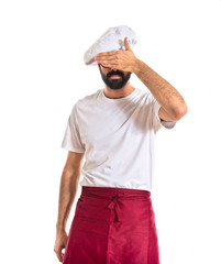 Chef covering his eyes