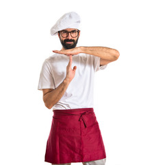 Chef making time out gesture over white background