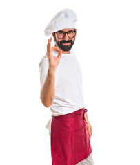 Chef making Ok sign over white background