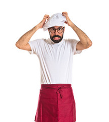Frustrated chef over white background