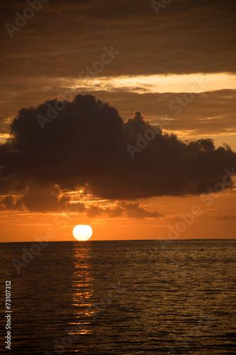canvas print picture Sonne versinkt im Meer
