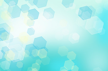 Abstract honeycomb background with bokeh effect.