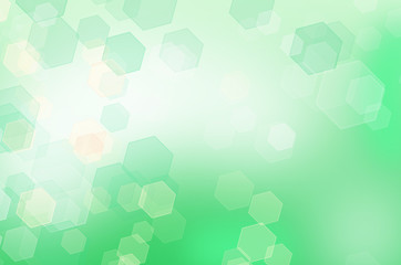 Abstract green honeycomb background with bokeh effect.