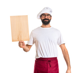 Chef holding a wood tool