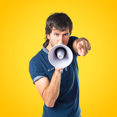 Man shouting over isolated yellow background