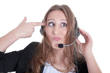 Callcenter Frau mit Headset dreht durch und gibt sich die Kugel