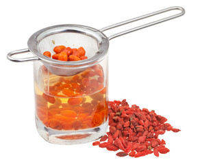 strainer in goji berries tincture and dried fruits