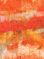 abstract ornament of painted orange silk batik
