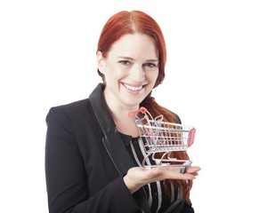 Young redhead woman holding a shopping cart