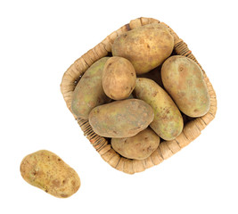 Russet potatoes in a basket with potato to the side