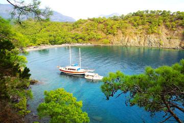 Calm bay with sail boat. Turkey