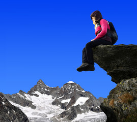 Girl sitting on a rock - Swiss Alps, Europe