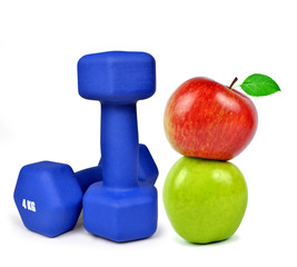 Blue fitness dumbbells with apples isolated