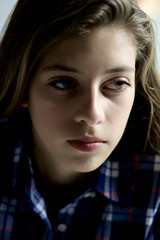 Portrait of female teenager thinking