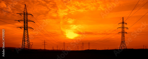 Fotobehang Zonsondergang Power lines at sunset